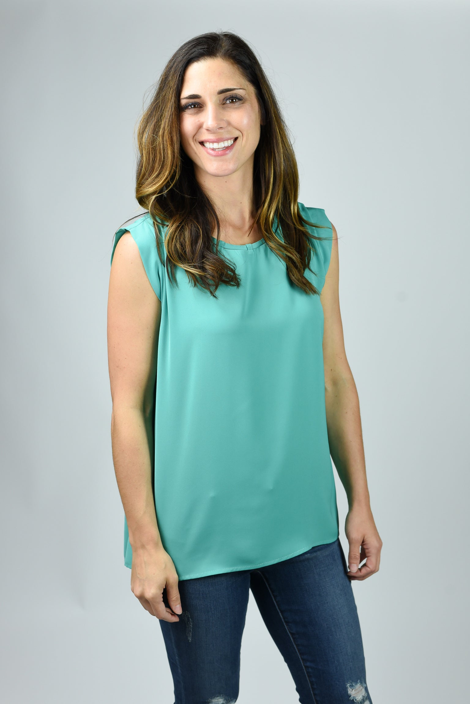 Disappearing Sunsets Jade Sleeveless Blouse