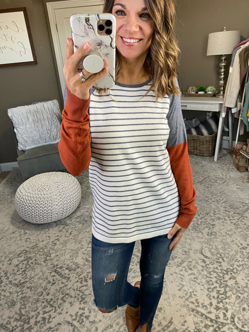 Never Been There Ivory and Charcoal Striped Sweater with Rust and Charcoal Sleeve