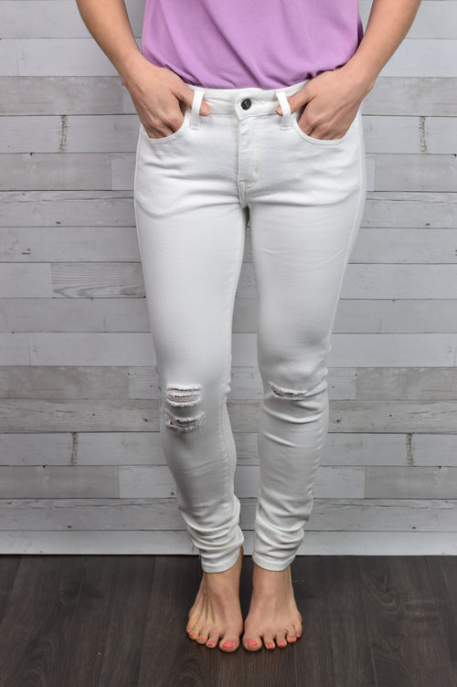 White Picket Fence Distressed Skinny Jeans