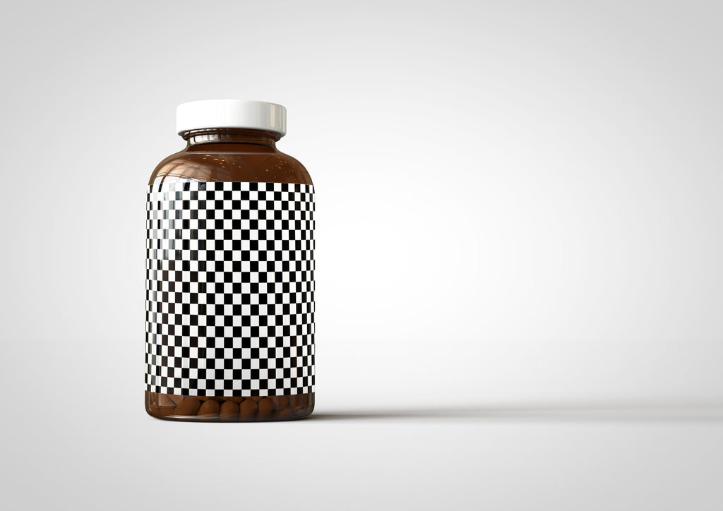 Amber Supplement Bottle With Pills Inside Bottle Mock-Up