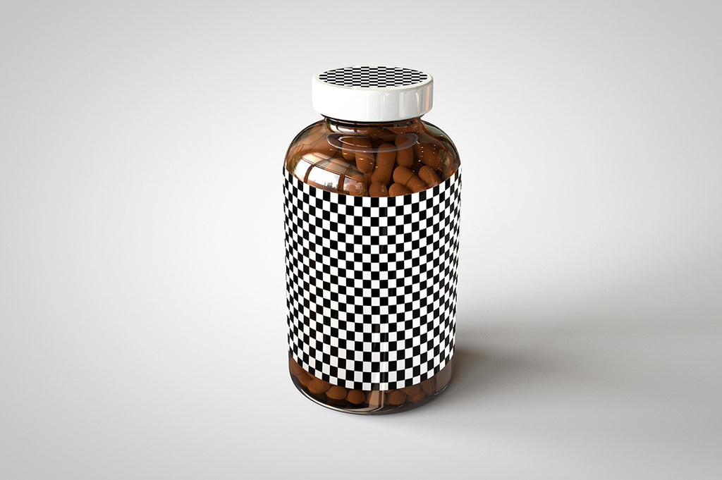 A shiny glass amber supplement/vitamins bottle mock-up full of pills on a white surface with an editable label on the front of the bottle and an editable sticker on the lid
