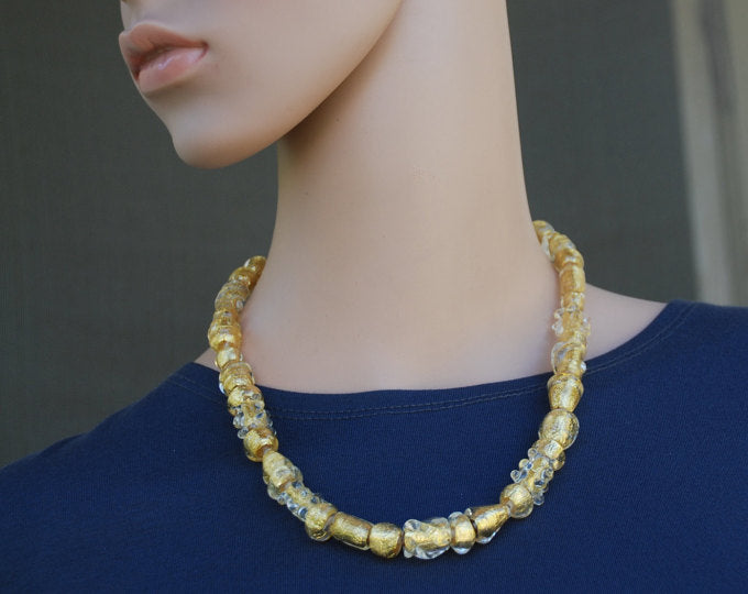 An extraordinary gold beaded necklace, smaller beads, lampwork glass beads, artisan necklace, flamework, 24k gold foil, Murano Glass