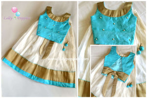 Blue RawsilkTop and Kotta Skirt with pearls and cut beads details.