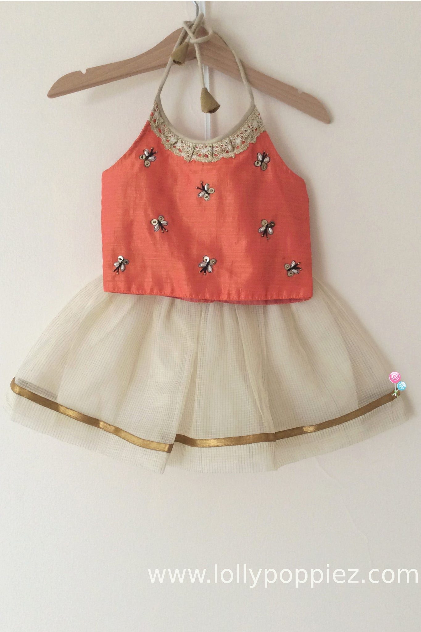 Peach semisilk top with butterfly pattern and kneelength tissue kotta skirt(LEW00020)