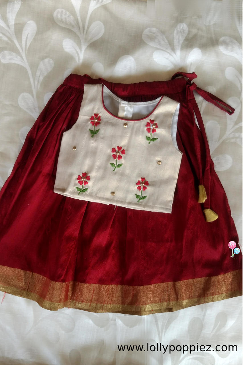 White shimmer top with red flowers and red rawcotton skirt with weaved border