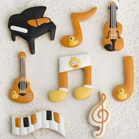 Image of Music Bumblebees Music Kitchen Music Themed Metal Cookie Cutters - Set of 4, Beamed Quaver, G Clef, Quaver and Guitar