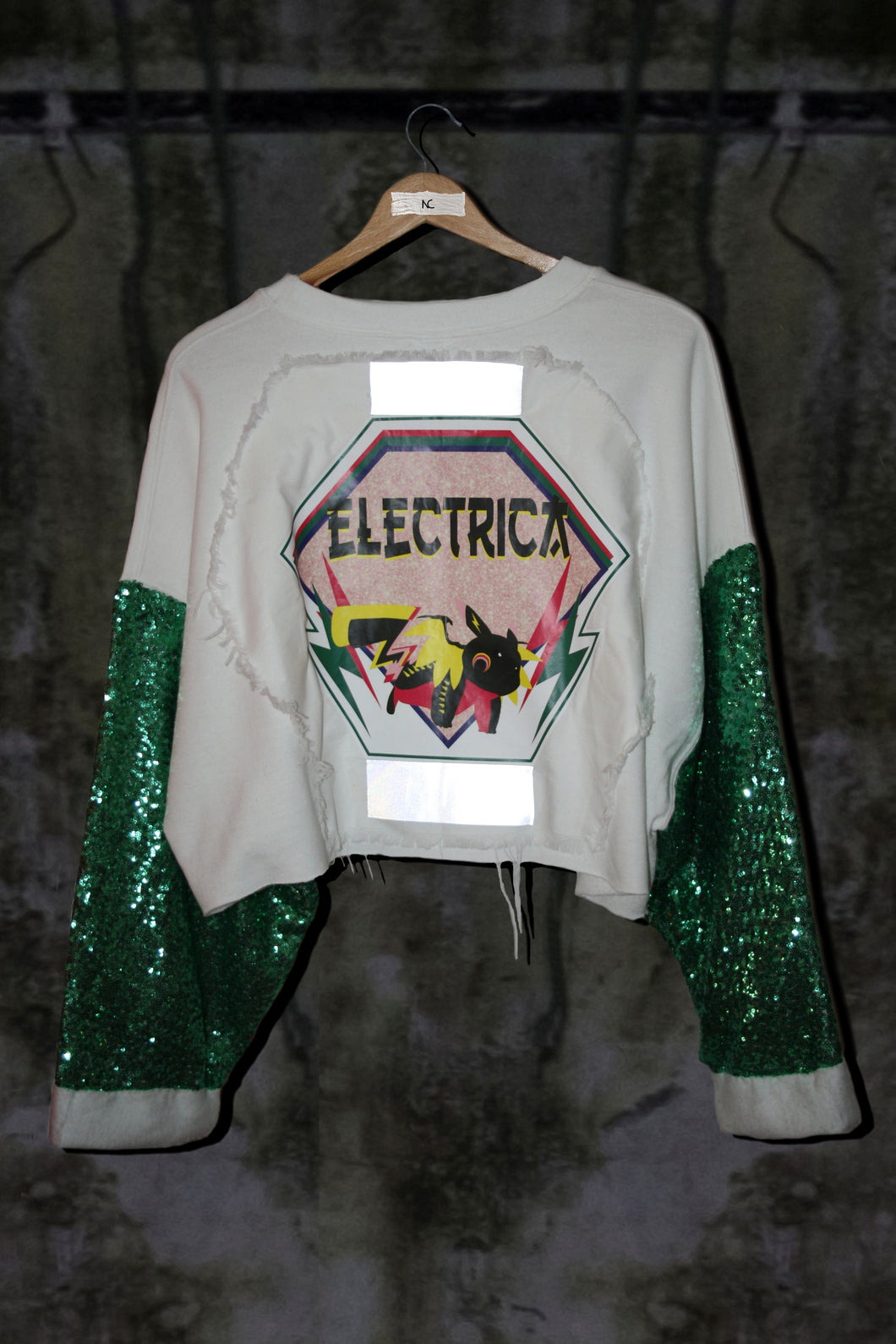 OVERSIZED CROP TOP WITH GREEN EMBELLISHED SEQUIN AND PINK LOGO - Noah Christian Studio