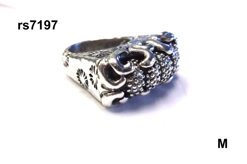 "sterling silver ""wave"" ring with seaflowers on shank and w/caviar top"