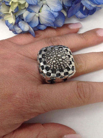 Sterling silver, caviar texture top ring, with sterling braid bezel and deep zig-zag sides