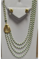 4-String Rice Pearl & Emerald Color Cubic Zirconia Mohan Mala