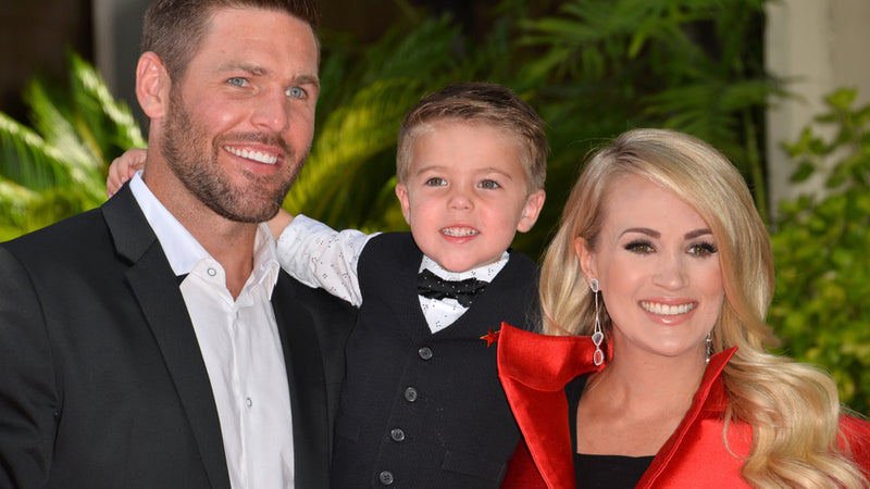 Carrie Underwood and husband Mike Fisher and son