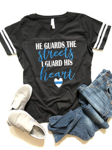 He guards the streets, I guard his heart