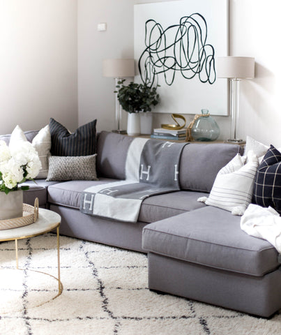 sectional with blanket in the middle