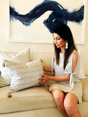 Jona Hackner of Hackner Home holding designer pillow