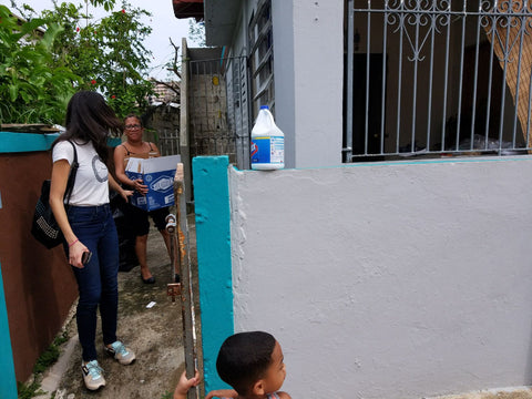 Around Eco Founder Jenn Velez providing help to Huracan Maria victims in Sanurce Puerto Rico