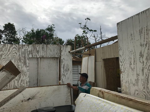 Man looking up to the sky while inside his on house at Huracan Maria in Puerto Rico photo by Around Eco