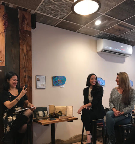 Around eco founder jenn velez smiling with female owners at panel discussion in nyc