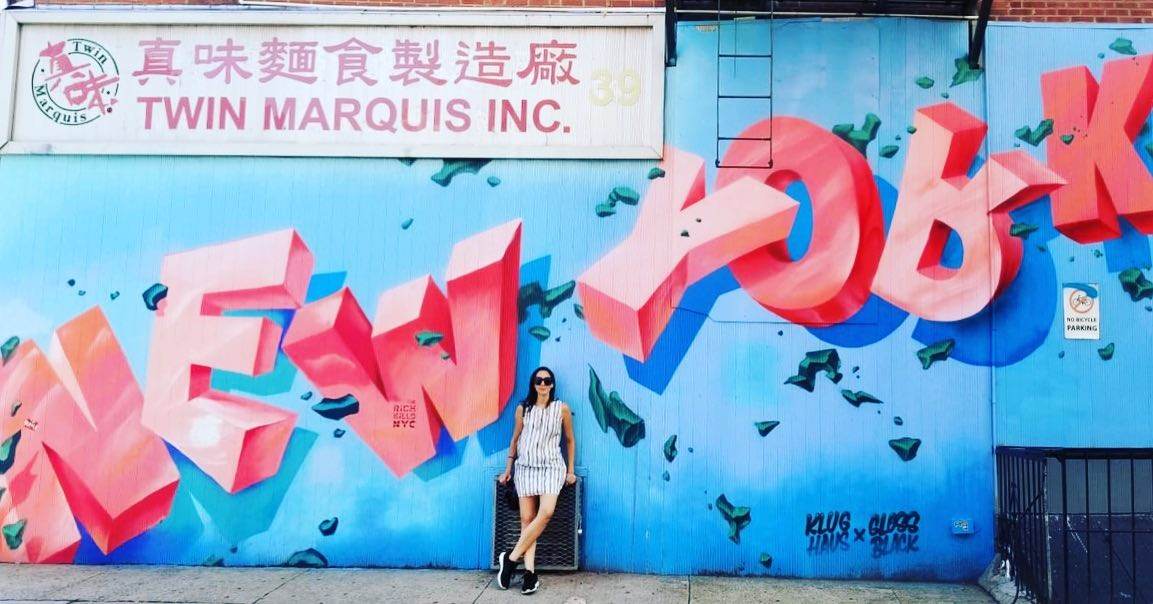 Around Eco Founder Jenn Velez in from of a New York Graffiti wall