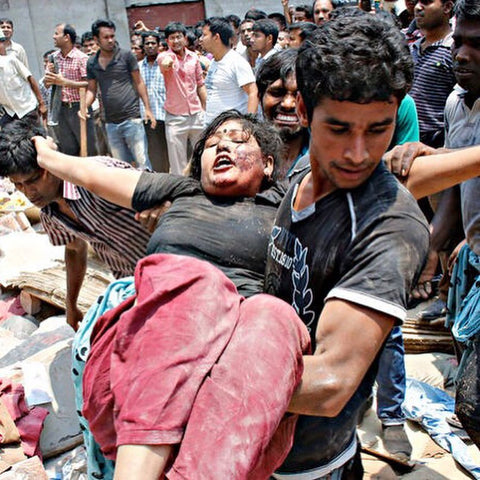 women being safe by a man at the Rana Plaza factory disaster