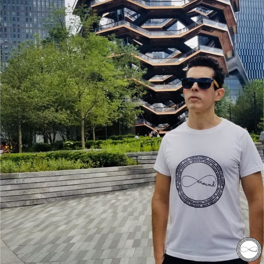 Male model wearing white Around Eco Logo graphic t-shirt