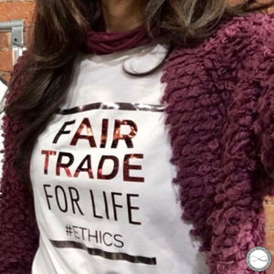 Female model wearing Around Eco fair trade and ecofriendly white graphic tee with the words Fair Trade For Life #ethics T-shirt