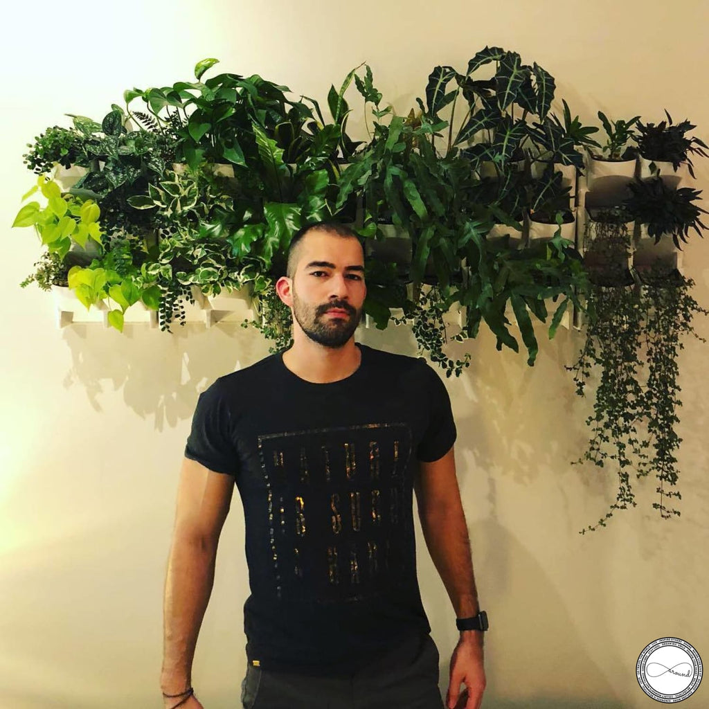 Male model wearing custom made Around Eco fair trade and ecofriendly dark gray graphic tee with the words Nature Is Such A Babe travel tshirt