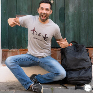Mochileando wearing custom made Around Eco fair trade and ecofriendly light gray graphic tee with the words Tú y Yo piénsalo travel t-shirt