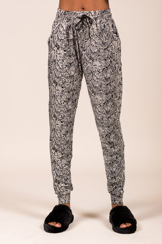 Invisible String Joggers in Snakeskin