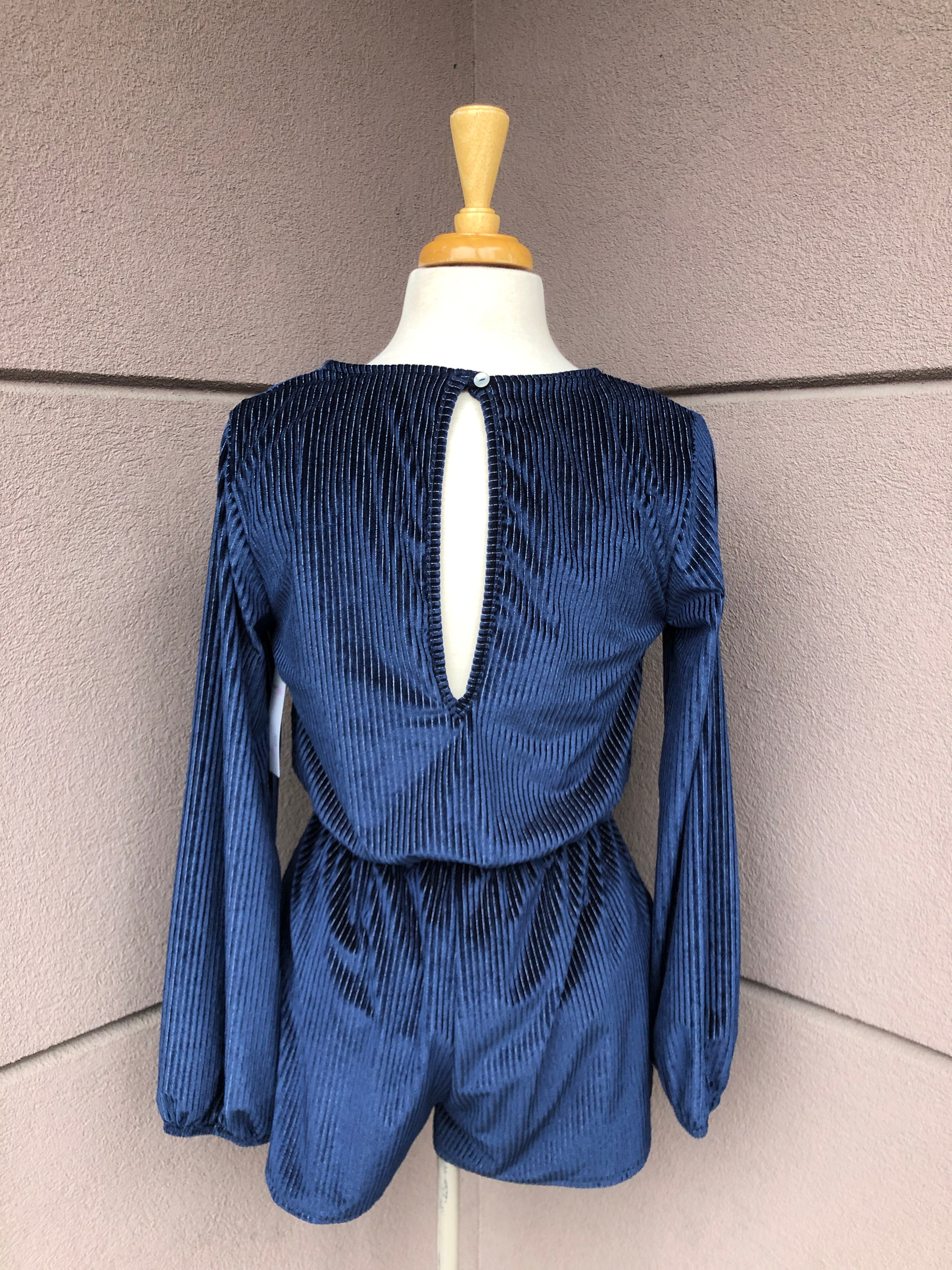 back view of blue romper