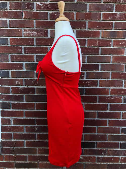 side view of red tie bust dress