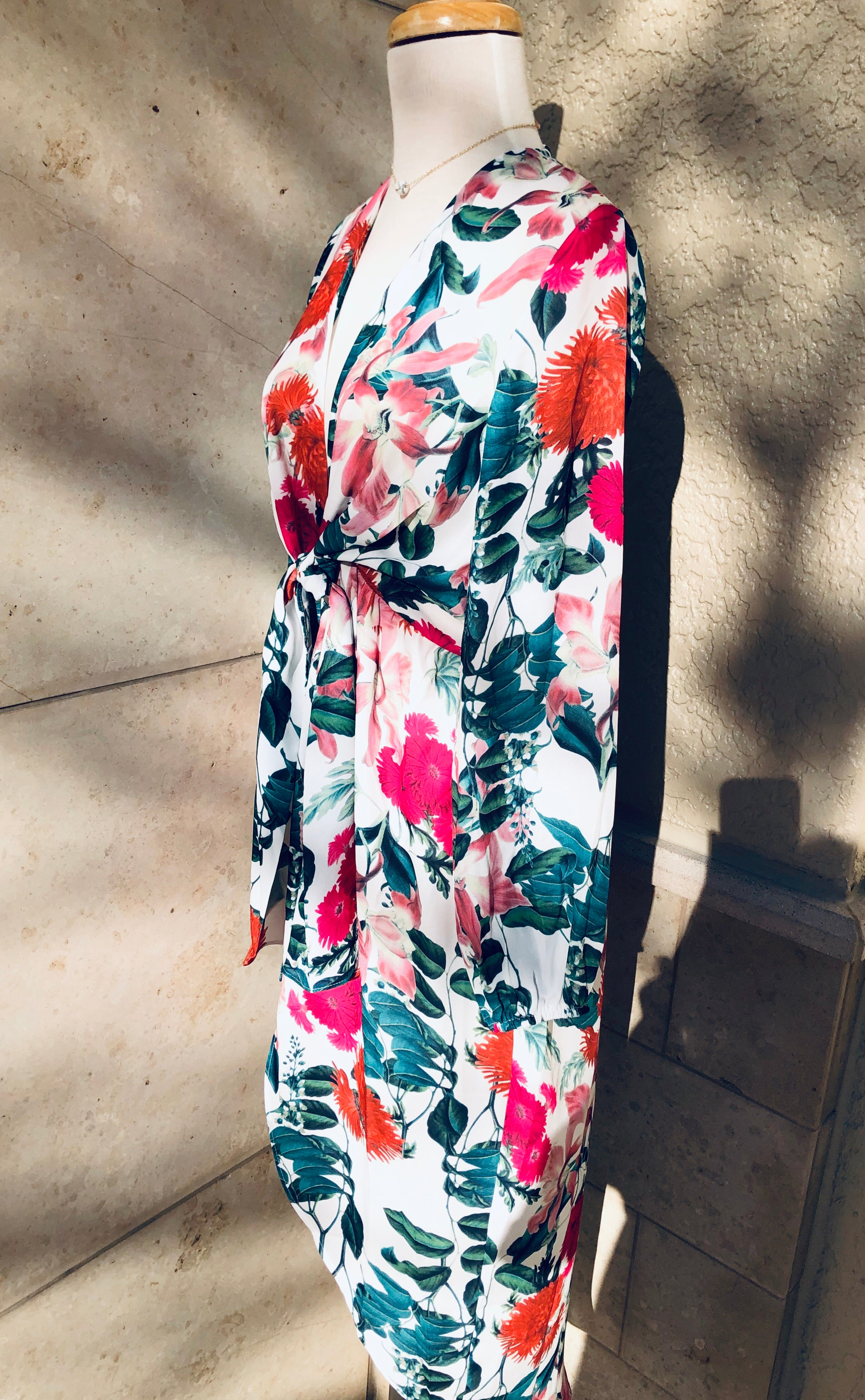 side view of detailing to floral hilow dress