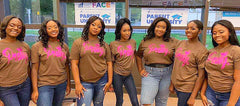 Pageant participants wearing Pretty Period T-shirts