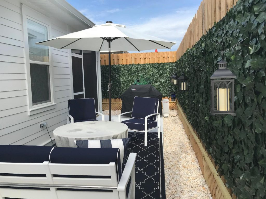 terrace with table, chairs, patio umbrella