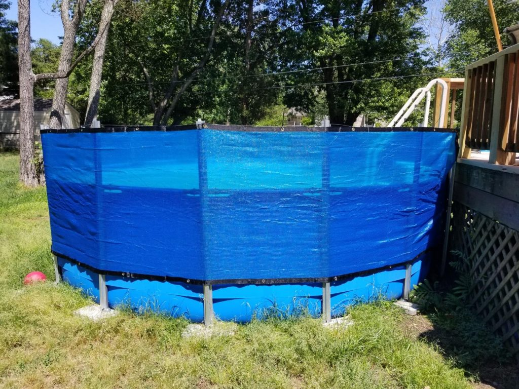 outdoor privacy screen installed around an above-ground pool