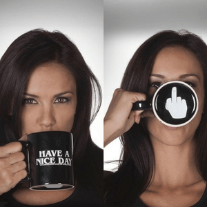 Have a nice day cup. Middle finger shows when drinking cup. Black cup with white letters. Black mug with white middle finger.