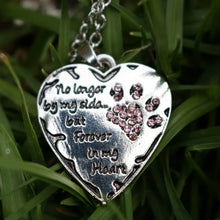 Forever in my heart necklace with grass background.