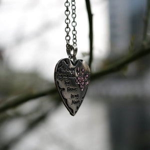 Forever in my heart pendant necklace hanging.
