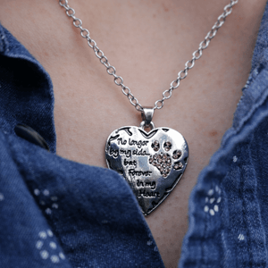 Model wearing heart shaped forever in my heart pendant necklace.