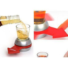 Shot spinner game with red arrow filled with drink.
