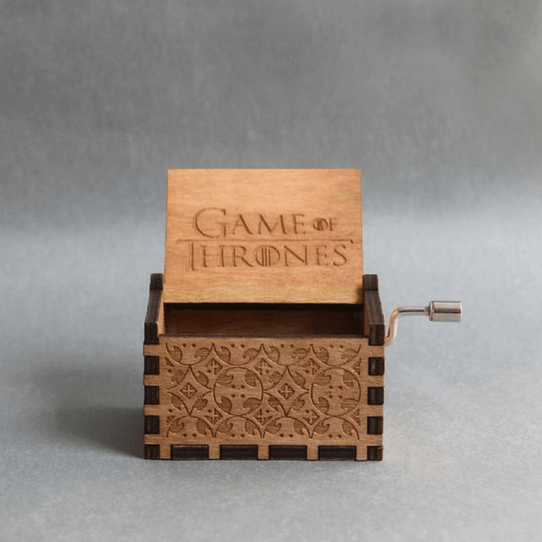 Game of thrones wooden music box with carved letters.