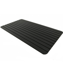 Black defroster tray for meat.