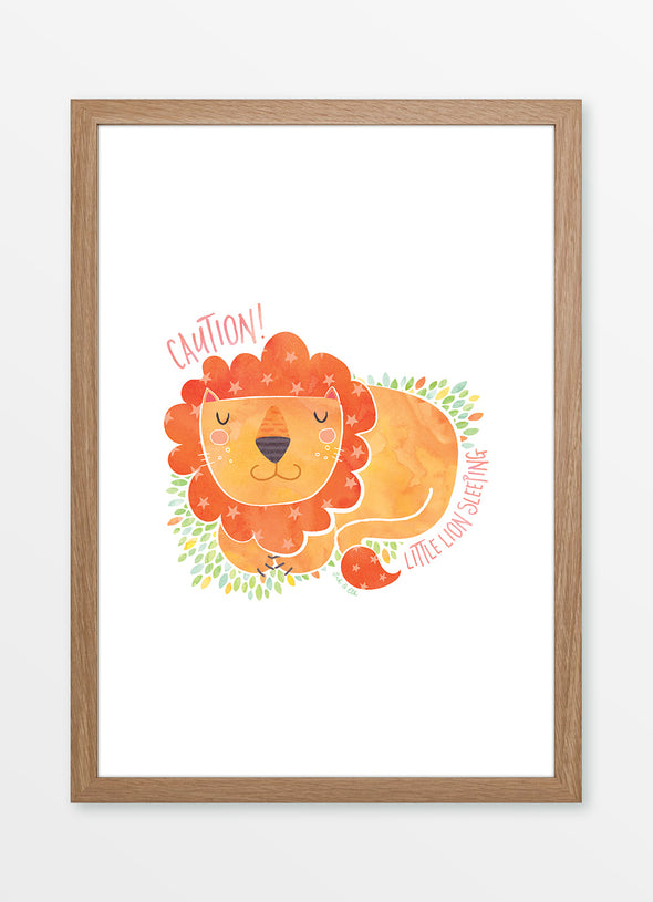 "Framed watercolour nursery print ""Little Lion Sleeping"", featuring a sleeping lion with the caption ""Caution! Little Lion Sleeping"""