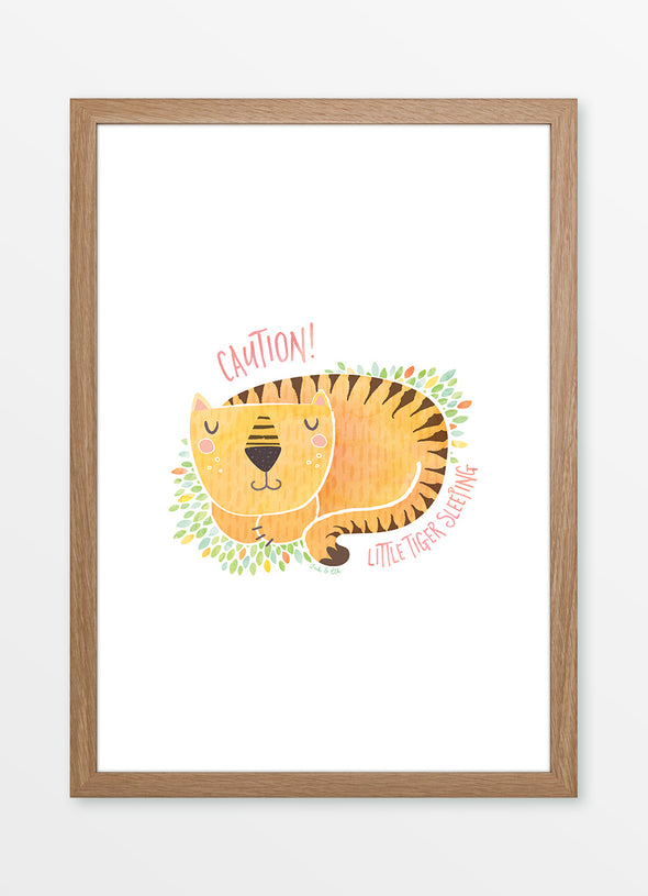 "Framed watercolour nursery print ""Little Tiger Sleeping"", featuring a sleeping tiger with the caption ""Caution! Little Tiger Sleeping"""