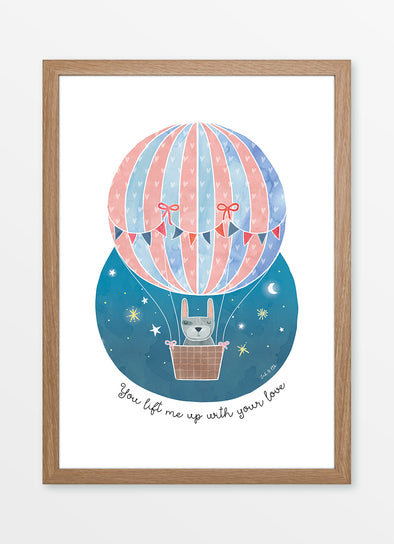 "Framed watercolour nursery print ""You lift me up with your love"", featuring a rabbit in a hot air balloon"