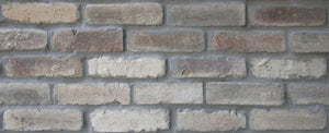 Sample of CHICAGO STYLE BRICK VENEERS- BEIGE COLOR. THIN CONCRETE BRICK VENEERS.