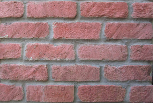 exterior brick veneer in large brick. Red brick tiles Florida.