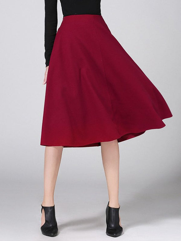Material: Cotton Blends,Polyester,Wool  Length: Knee-Length  Silhouette: A-Line  Pattern Type: Solid  Embellishment: Vintage  Season: Fall,Winter  With Belt: No  Weight: 0.470kg  Package Contents: 1 x Skirt
