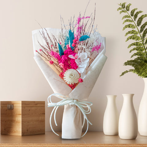 Artificial Bouquet for gifting kept on a table