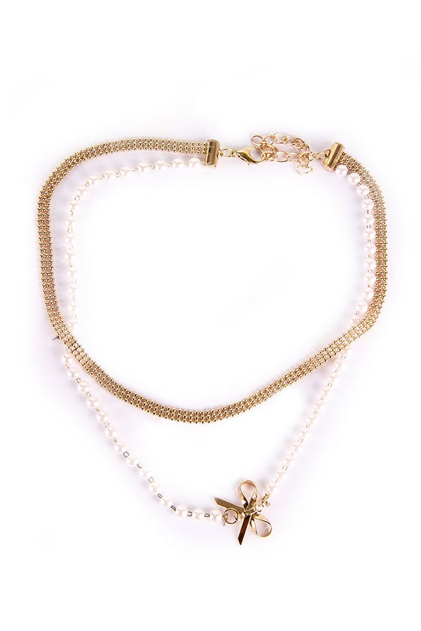 BOW PENDANT PEARLS AND GOLDEN CHAIN NECKLACE - Mantra Pakistan
