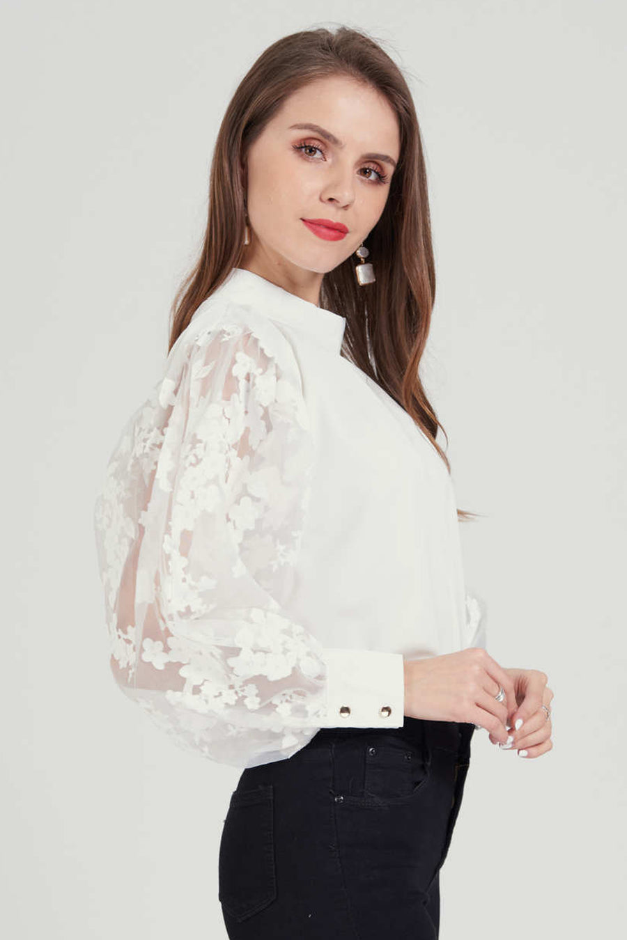 Mock neck top with floral lace sleeve
